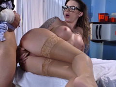 A kitten with glasses and large tits is fucked in her oozy fuck hole
