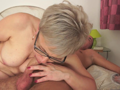 Lascivious blonde granny gets nailed by a handsome young-looking stud so well
