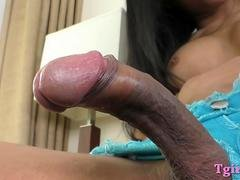 Slim busty brunette transsexual has an intercourse her butt with a dildo