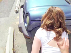 Brooke Wylde is getting down and dirty outside by a car
