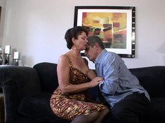 A granny is getting fucked by a horny old dude on the sofa