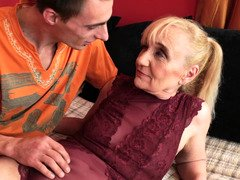 A granny is getting her old pussy ravaged by a young eager guy