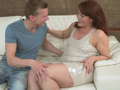 Experienced redhead gets her pussy plowed by lover's cock