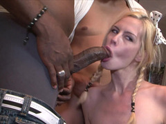 A little blonde is getting fucked by several black fellas in a group-fuck