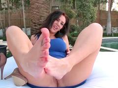 Smutty brunette honey gives a kinky foot job near a pool