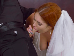 A busty redhead with large tits is getting rammed hard on the bed