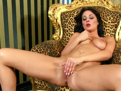 Euro slut in a sexy dress drops her outfit and masturbates