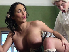 A busty thing is getting fucked in front of a fireplace