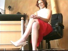 Sexy short haired brunette plays with a vibrator, spreads
