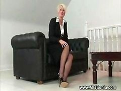 Mature female shows her lascivious lingerie