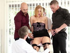 A lovely woman is taking on four guys at the same time in a gangbang
