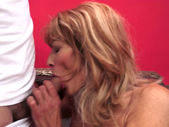 Raunchy granny blows a big dong and rides it later so damn fine