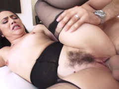A bitch with hair on her pussy is fucked in her ass really hard