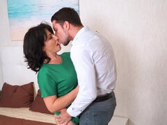 Dark haired mature fucking her young lover in bed