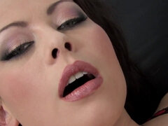 Charming babe with lusty lips fucks herself on the couch