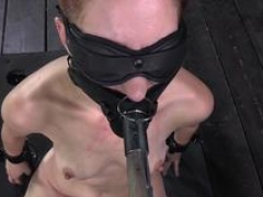 Drooling submissive blindfolded during BDSM