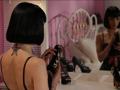 Asphyxia Noir masturbates wearing high stockings & high heel shoe