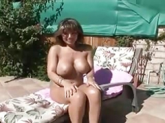 Big-breasted brunette milf blows the pool boy