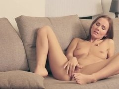 Amazingly hot, beautiful babe masturbates on her sofa