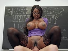 Well-rounded black teacher and student have sex in the classroom