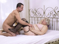 Horny granny Astrid in stockings fucks her foster son