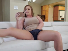 Maddy O Reilly plays with glass dildo on the couch