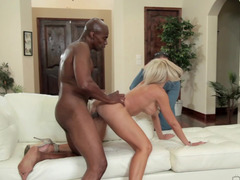 A black man sticks his purple pole in a blonde while a cuckold watches