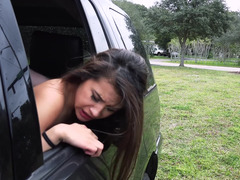 A sexy non-professional is filmed getting fucked in the car while outdoors