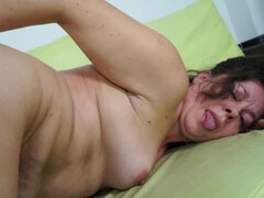 Horny mature slut getting her pussy wet