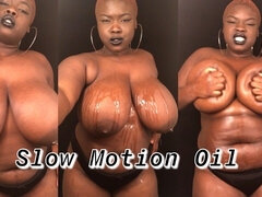 Slow Motion of BBW Rubbing Oil on Natural Black Tits & Curvy Body