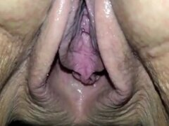 Close-up video of the cum dripping out of granny's cunt