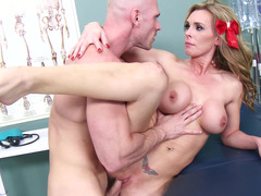 A blonde is getting fucked actually hard on her back in a clinic