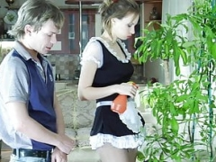 Maid makes love the owner with a strapon