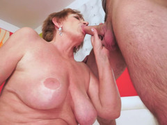 Lustful granny with big milk sacks gets nailed by a handsome stud