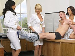 Clothed females tormenting submissive naked males