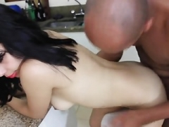 Aroused man fucks busty girl in kitchen