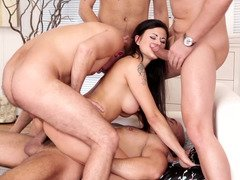 Hot chick gets a double penetration in the gangbang she is having