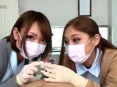 2 Nurses in Latex Gloves Teasing Patient