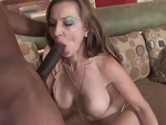 Brunette mature loves choking on a thick long black pole