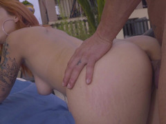 A redhead that loves to give bj removes her bikini outdoors and gets to work