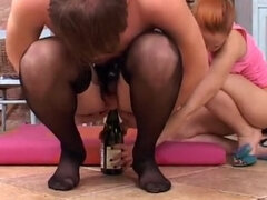 Femdom facesitting & ass fucking sissyboy with a champagne bottle