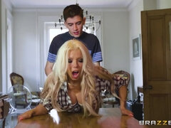 Busty housewife in a plaid skirt gets plowed on the kitchen table