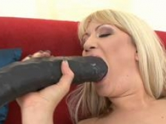 Large vibrator disappears in her tight ass