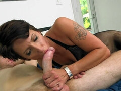 Short haired woman is sucking dick