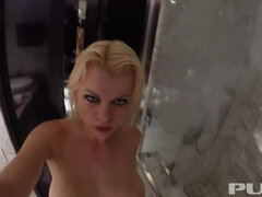 Busty blonde Nadia washes off in a big shower