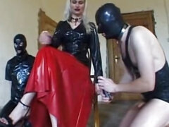 Bossy Mistress in fetiche outfit in threesome femdom session