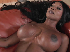 A black dame that has huge bra buddies blows off a large white pecker