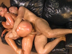 Oiled up Nikki Benz stretched with a massive cock