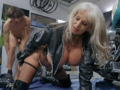 Pornstar in leather jacket loves using younger males for fucking