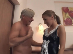 A young slutty maid is getting her tight ass drilled by a dildo